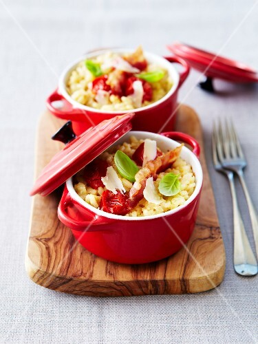 Risotto with parmesan,tomatoes and smoked bacon served in small casserole dishes