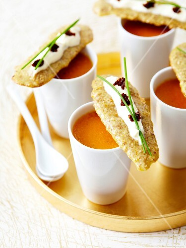 Lobster bisque,sesame crackers garnished with cream and lumpfish roe
