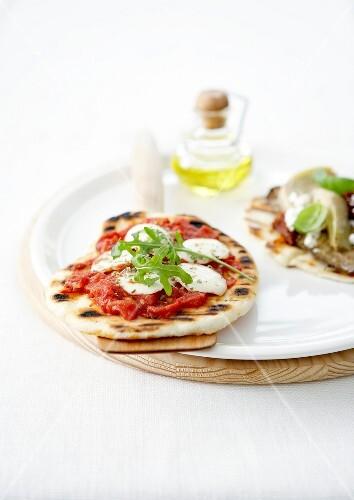 tomate-mozzarella small pizza and artichoke-anchovy-basil small pizza