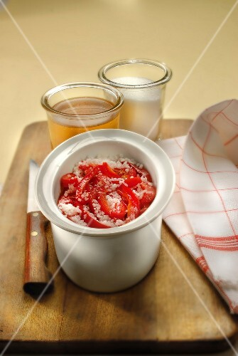 Red peppers in coarse salt