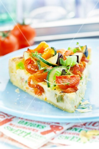 Slice of goat's cheese and vegetable quiche