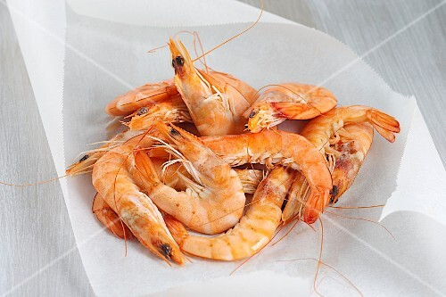 Fresh shrimps on a sheet of wax paper