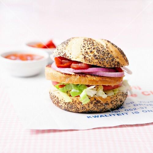 Vegetarian burger in a poppyseed bun