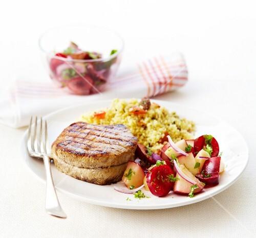Grilled pork steak,summer fruit salad and sweet semolina