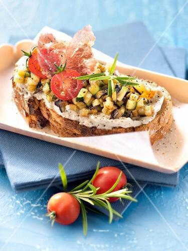 Cream cheese, coppa, and summer vegetable bruschettas