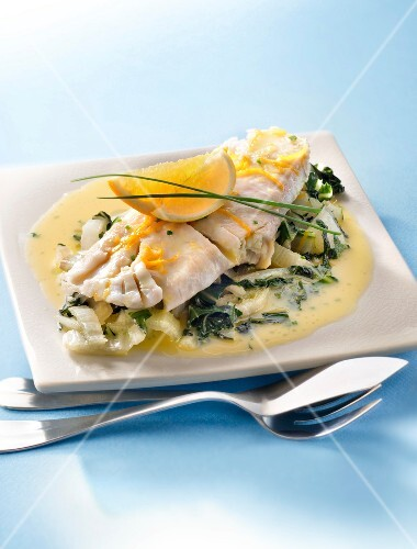 Cod fillet in lemon butter sauce and pan-fried Swiss chard