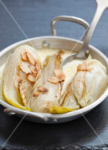 Braised chicory with cream and thinly sliced almonds