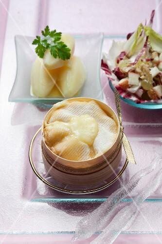 Hot Mont d'Or and crisp Trevise lettuce salad