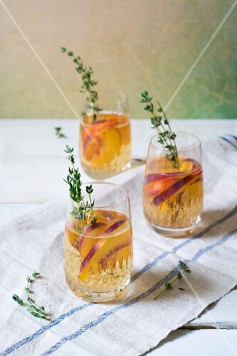 Glasses of peach and thyme Sangria