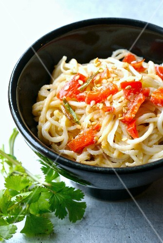 Chinese noodles sauteed with red peppers and sesame seeds