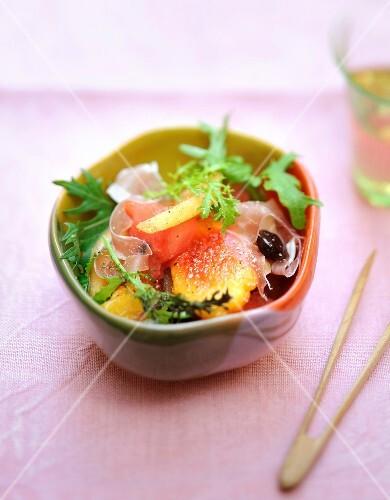 Melon,watermelon,raw ham and black olive salad