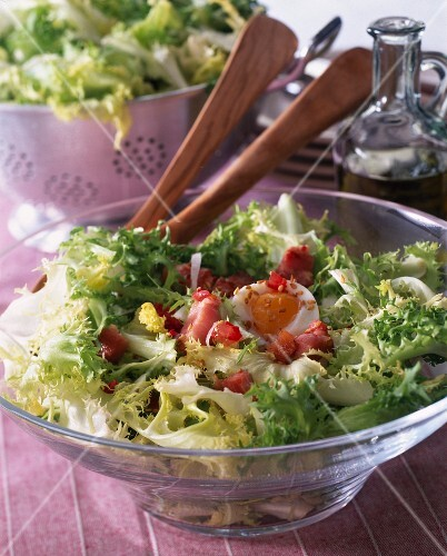 Chicory lettuce with diced bacon and a soft-boiled egg