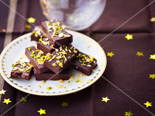 Chocolate ingots topped with crushed pistachios