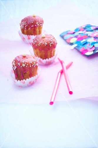 Vanilla cupcake-style Cannelés with raspberry frosting