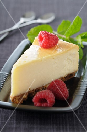 Slices of cheesecake with raspberries