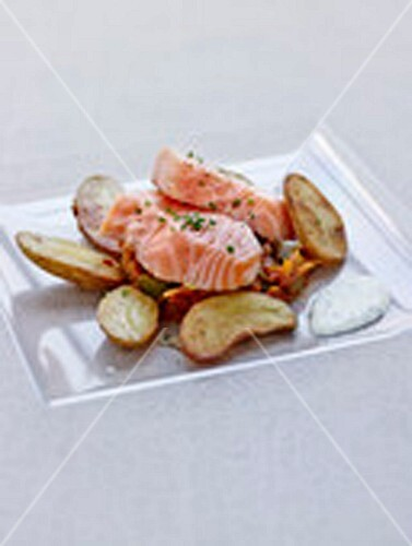 Marinated salmon with roasted potatoes and stewed summer vegetables
