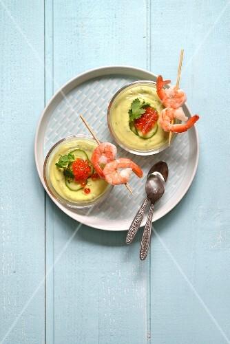 Avocado soup with shrimps and cilantro