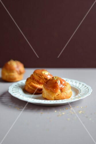 Salted butter toffee cream puffs decorated with golden flakes