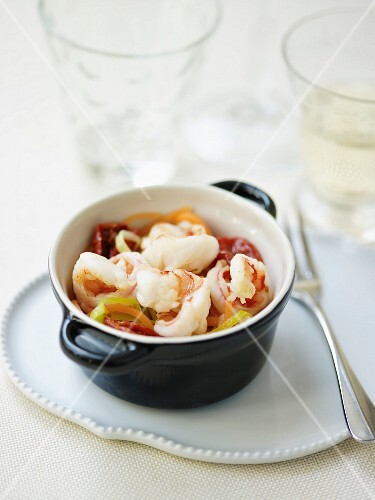 Gambas,confit tomato and thinly sliced pepper casserole in citronella sauce