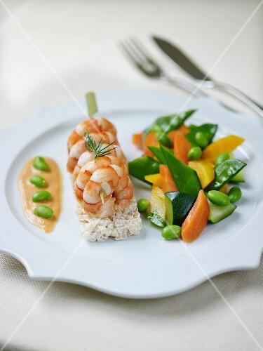 Roasted gambas brochettes,Fregola sarde with creamy parmasan sauce,mixed season vegetables