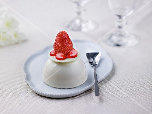 Vanilla-flavored panna cotta dome topped with strawberry
