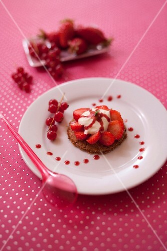 Digestive biscuit garnished with summer fruit and fromage blanc