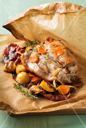Rabbit and vegetables cooked in wax paper