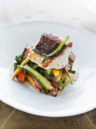 Pan-fried spring vegetables topped with steamed cod