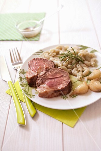Slices of roast leg of lamb with rosemary and garlic