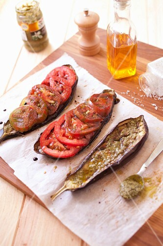 Grilled eggplants with pesto and tomatoes