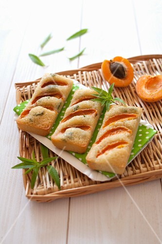 Financiers (French almond sponge cakes) with apricots, lemon balm and olive oil