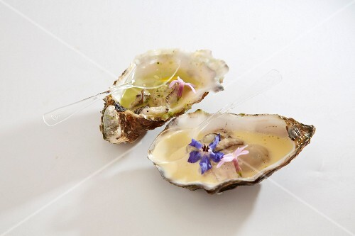 Oysters with white butter sauce and edible flowers