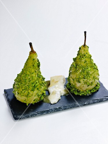 Poached pears coated in pistachios and gorgonzola