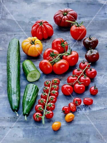 Various tomatoes and cucumber