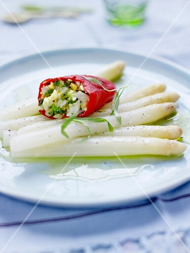 White asparagus with vinaigrette, stuffed red peppers with fish, broccoli and celery