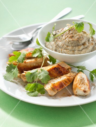 Spicy grilled chicken breast with eggplant puree