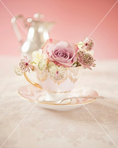 Bunch of flowers in a tea cup