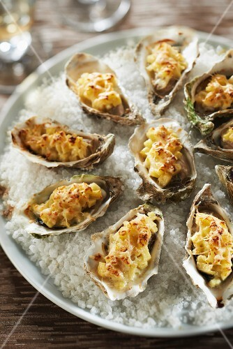Oysters grilled with diced apples,shallots and curry