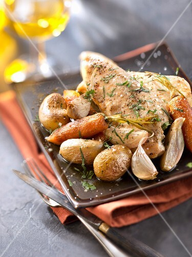 Roasted guinea-fowl breasts with herbs,slow cooked vegetables