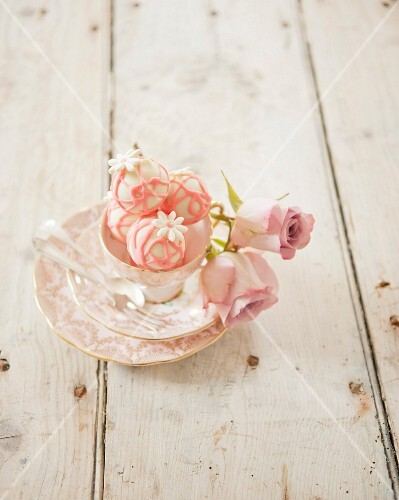 Sweet flowery bites and tea cups