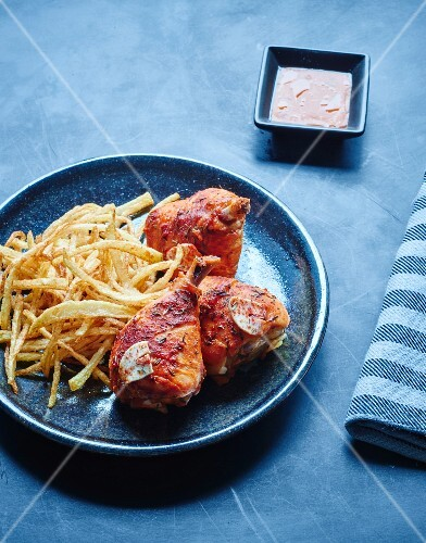 Tandoori chicken drumsticks with straw potatoes