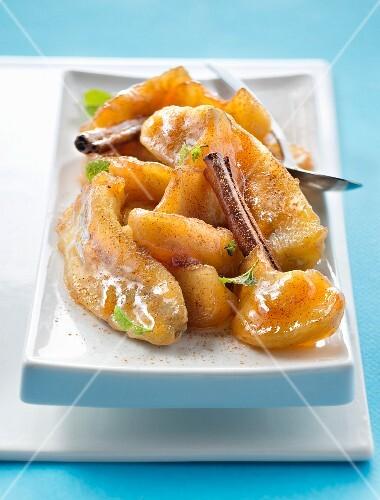 Pan-fried bananas and apples with cinnamon