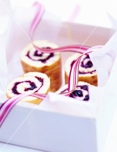 Blackcurrant jam sliced rolled log cake