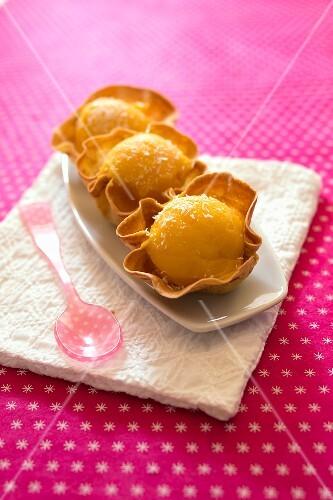 Mango sorbet in crisp tulip casings