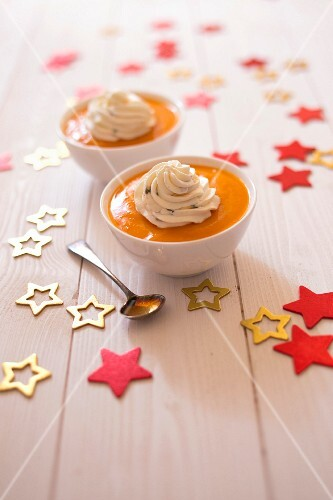 Cream of pumpkin soup ,savoury passionfruit whipped cream