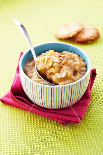 Stewed apples and pears with toffee and thinly sliced almonds