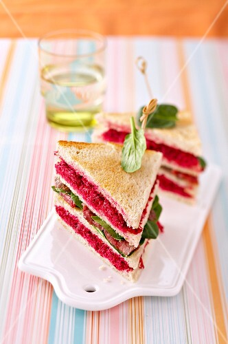 Beetroot puree,roast beef and baby spinach leaf club sandwich
