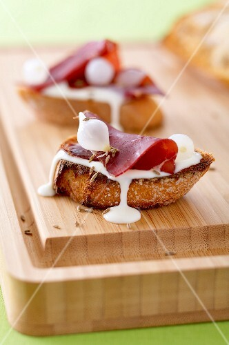 Cancoillotte cheese,grisons meat and garlic Crostinis