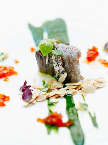 Pressed anchovies with citrus fruit,green coulis and thinly sliced almonds