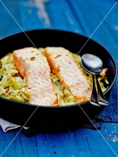 Salmon fillets on a bed of leeks